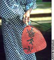 A woman in a yukata at the hot springs of Arima