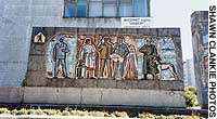 A crumbling mosaic-tile monument in the main square of Yuzhno-Sakhalinsk pays tribute to the working people.