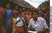 Conservationist Niranjan Raptan, pictured with Sunderbans residents, believes that better farming techniques would eliminate the need for locals to venture into tiger territory in search of food.