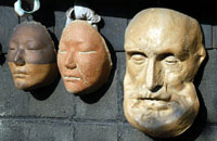 Ceramic masks outside a pottery store