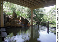 A free outdoor onsen at Uramigataki is perched on a hill overlooking a lush valley