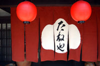 Lanterns at the doorstep of an eatery