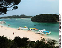 Kabira Bay may be the most attractive spot on Ishigakijima Island, Okinawa, but with swimming forbidden, its appeal is in what lies beneath the surface of its blue seas.
