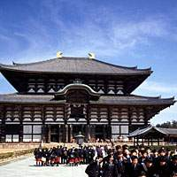 Posing for photos in front of Todaiji on a school trip; and (bottom) a rickshaw man looks for customers