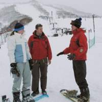 Foreign snowboarders exchange tips on one of Hirafu-Niseko's many slopes, which are famous for their exceptional powdersnow. | KYODO PHOTOS