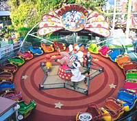 A spiffy new spinner at Hanayashiki Amusement Park (top); morning glory vendors at Chokoku Temple; a yakatabune moored near the former geisha district of Yanagibashi