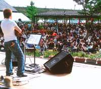 Visitors enjoy music at the Takahata Winery harvest festival in October 2006; employees work at the Takahata Winery.