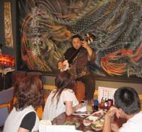 At his izakaya, Aiya, Kazuo Shibutani takes center stage at a Tsugaru shamisen live show; Atsushi Tada, a Tsugaru shamisen player from Hirosaki City