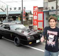 Yoshinao Hirata stands next to his 1973 XB GT Ford Falcon replica 'Mad Max' Inteceptor near his home in Chofu, in western Tokyo. | PETER LYON PHOTOS