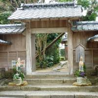Past glories: A formal garden glimpsed through a gateway in Izumi's samurai quarter (left), and inside the Takezoe residence there.