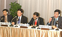 Josef Yap, president of the Philippine Institute for Development Studies, speaks while his co-panelists -- (from left) Vo Tri Thanh, Sompop Manarungsan and Muhammad Chatib Basri -- listen during the Dec. 2 ASEAN-Japan synposium at Keidanren Kaikan.