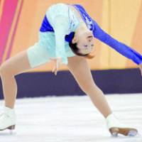 Olympic gold medalist Shizuka Arakawa performs the maneuver called the Ina Bauer during the Winter Games in Turin, Italy, in February 2006. | KYODO PHOTO