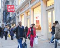 The sidewalk bustles in New York's Soho district, which hosts Uniqlo, Muji, H&M and a number of other affordable fashion and interior design stores. | KYODO PHOTO