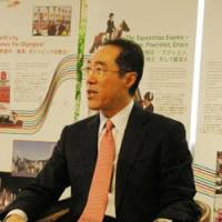 Henry Tang, chief secretary of the administration of the Hong Kong Special Administrative Region, speaks Tuesday at the Hong Kong Economic and Trade Office in Chiyoda Ward, Tokyo. | REIJI YOSHIDA PHOTO