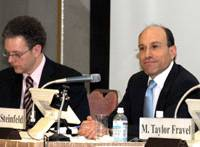 Edward Steinfeld (right) and George Gilboy discuss China's economic, social and political changes during the Jan. 23 symposium. | SATOKO KAWASAKI PHOTO