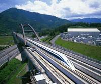 A maglev train runs on a test course in Yamanashi Prefecture. The train's developer, Central Japan Railway Co. (JR Tokai), hopes the high-speed transport will pay off in the future. | CENTRAL JAPAN RAILWAY PHOTO