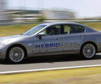 Silent speed: A prototype of Nissan Motor Co.'s new gasoline-electric hybrid speeds along the automaker's test course Wednesday in Yokosuka, Kanagawa Prefecture. | AP PHOTO