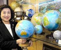 Globe maker president on top of the world