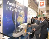 Streamlined: Visitors check out the Pac Car II, the world's most fuel-efficient vehicle according to Guinness World Records, at the 5th International Hydrogen & Fuel Cell Expo at Tokyo Big Site in Koto Ward on Wednesday. The vehicle was made by Swiss students. | YOSHIAKI MIURA PHOTO