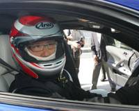 No back-seat driver: Incoming Toyota Motor Corp. President Akio Toyoda sits behind the wheel of a Lexus for a test drive on the Fuji Speedway Formula One racing course in Oyama, Shizuoka Prefecture, in October 2007. | AP PHOTO