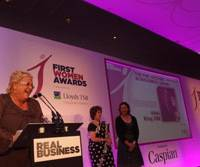 Breaking barriers: Nikki King of Isuzu Truck UK Ltd. picks up her award for lifetime achievement at the First Women Awards in London on June 11. | NIKKI KING / KYODO
