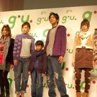 Cheap chic: Young people model outfits coordinated by popular TV personality Akina Minami for g.u., a clothing chain run by GOV Retailing Co., at a media event in Tokyo's Roppongi district Tuesday. | KAZUAKI NAGATA