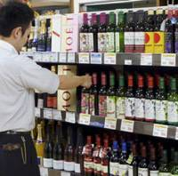 Priced to chug: Low-priced wines pack the shelves of the wine section at a Daiei supermarket in Meguro Ward, Tokyo. | KYODO PHOTO