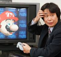 Mario magic: Shigeru Miyamoto, creator of Nintendo Co.'s long-selling Super Mario video game series, demonstrates 'Super Mario 64' in his Kyoto office in 1997. | AP PHOTO