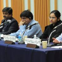 Journalists and experts from India (from left) Rajeev Anantaram, Jayanta Roy Chowdhury, Prakash Nanda, Vidhi Upadhyay and Rajaram Panda discuss India's deepening ties with East Asian economies during a symposium held Sept. 15 at Keidanren Kaikan in Tokyo. | SATOKO KAWASAKI