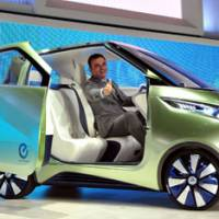 Nissan Motor Co. CEO Carlos Ghosn shows off the PIVO 3, a zero-emission concept car, during the Tokyo Motor Show on Wednesday. The event at Tokyo Big Sight opens to the public Saturday and runs through Dec. 11. | YOSHIAKI MIURA PHOTO