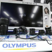 Out in the open: Olympus Corp. cameras and lenses are displayed at a store in Tokyo on Thursday. | AP