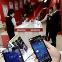 two smartphones are shown at a Bic Camera outlet in Tokyo's Yurakucho district on Nov. 22. | KYODO