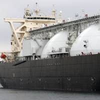 &#165;1 trillion guarantee: A liquefied natural gas tanker operated by Energy Advance Co., a unit of Tokyo Gas, lies moored at the company's plant in Sodegaura, Chiba Prefecture, last March. | BLOOMBERG