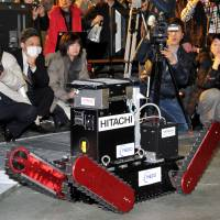 On track: The Tsubaki robot, developed by a startup firm of Chiba Institute of Technology, goes through its motions Wednesday in Narashino, Chiba Prefecture. | YOSHIAKI MIURA