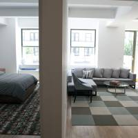Living large: A model one-bedroom apartment is pictured at the 99 John Deco Lofts condo building in New York in July 2010. Prices in the Big Apple are rising rapidly as buyers venture back into the housing market. | BLOOMBERG