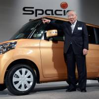 The way ahead: Osamu Suzuki, Suzuki Motor Corp. chairman, introduces the new Spacia minicar Tuesday in Tokyo. | AFP-JIJI