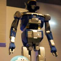 The HRP-2 robot developed by Japan's National Institute of Advanced Industrial Science and Technology towers over Bandai's Doraemon robot (above) at the National Museum of Nature and Science, Tokyo; Shobe Tamaya IX's tea-serving karakuri clockwork doll (below) | TIM HORNYAK PHOTOS