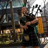 A bagpiper does his thing in the St. Patrick's Day parade. | MALLOCUP PHOTO