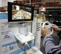 Window shopping: A customer plays a Nintendo Wii game at a store in Mountain View, Calif., last year. | AP PHOTO