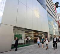 Buzz in the box: Apple's latest upgrade to its iPod Nano device will put pressure on Japanese cellular phone companies to upgrade their products. | YOSHIAKI MIURA PHOTO