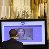 Blogger in chief: U.S. President Barack Obama listens to a video question submitted from the Internet during an 'Open For Questions' town hall-style meeting in the East Room of the White House in Washington earlier this year. The Obama administration has embraced the Internet as a means of communication with the public. | AP PHOTO