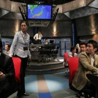 Flying high: Ayako Kawahara (center left) and cast in action on the set of Sony and Fuji TV's 3-D drama 'Tokyo Control.' | FUJI TV