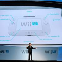 Wii are the world: Nintendo Co.'s president, Satoru Iwata, unveils the company's first high-definition video-game console, the Wii U at E3 last Tuesday. | AP PHOTO