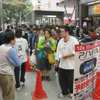 First in line: Customers queue for Sony PlayStation Vita preorders. | KYODO PHOTO