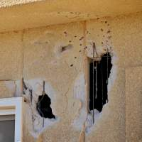 Battle scars: A cafe in Ain Amenas, Algeria, on Thursday is seen damaged from blasts and gunfire from the hostage crisis at the nearby gas plant where 10 Japanese workers were killed. | KYODO