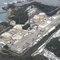 Power tripped: Kansai Electric Power Co.'s nuclear plant in Oi, Fukui Prefecture, is seen in December. | KYODO