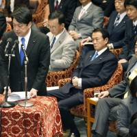 Tough talk: Defense Minister Itsunori Onodera responds to a question while Prime Minister Shinzo Abe (right), Finance Minister Taro Aso and other ministers look on Thursday during a Lower House Budget Commitee session. | KYODO