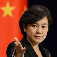 Hard words: Chinese Foreign Ministry spokeswoman Hua Chunying faces reporters Thursday in Beijing. | KYODO