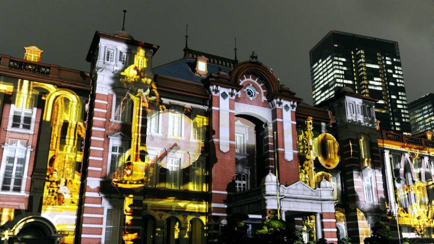 Swaying with the beat: Images of musical instruments are projected on the walls of JR Tokyo Station on Sept. 21 during a media preview of the commemoration celebrating the building's restoration.