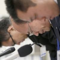 Coach axed: Osaka city board of education officials apologize Wednesday at City Hall as they announce the firing of Sakuranomiya Senior High School basketball coach Hajime Komura, 47, for alleged violence against his team's captain, who hanged himself in December. | KYODO
